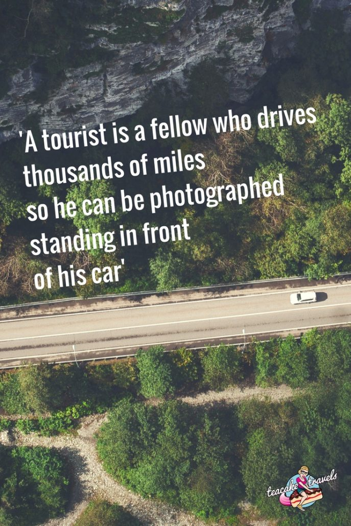 "Funny travel quotes about seeing the world: ""A tourist is a fellow who drives thousands of miles so he can be photographed standing in front of his car"" - Emile Ganest"