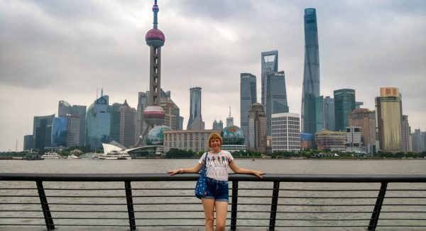 Blogger Alice standing in front of Shanghai City buildings skyscrapers