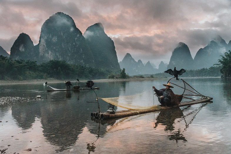 Fisherman along the Li River in China Xingping