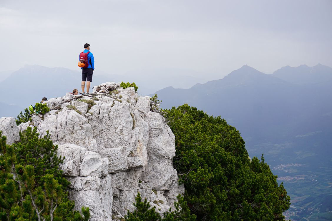 Man looking out across the Paganella Dolomites above Andalo
