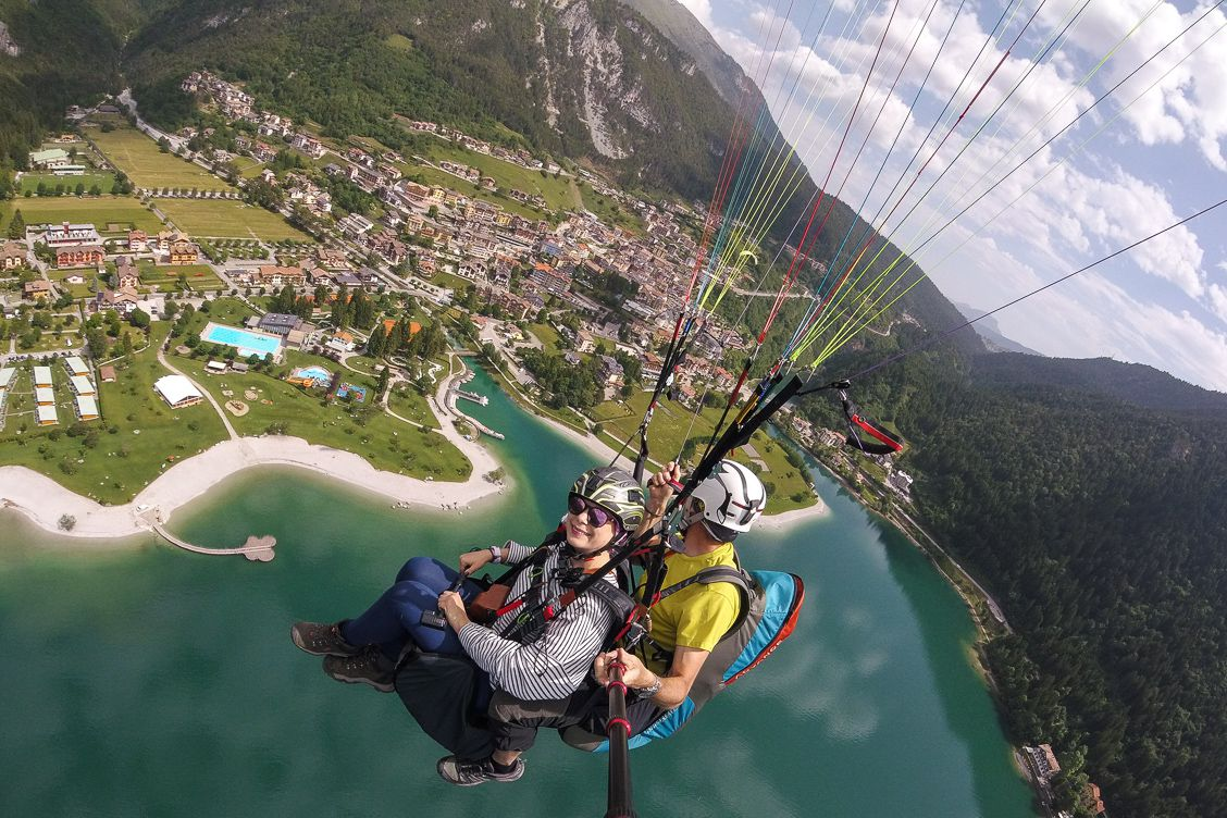 Alice Teacake paragliding with her instructor Stefano above Lake Molveno