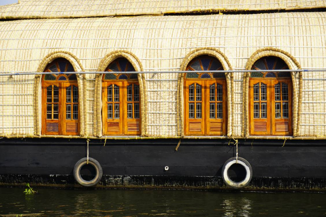 Side view of a houseboat with doors