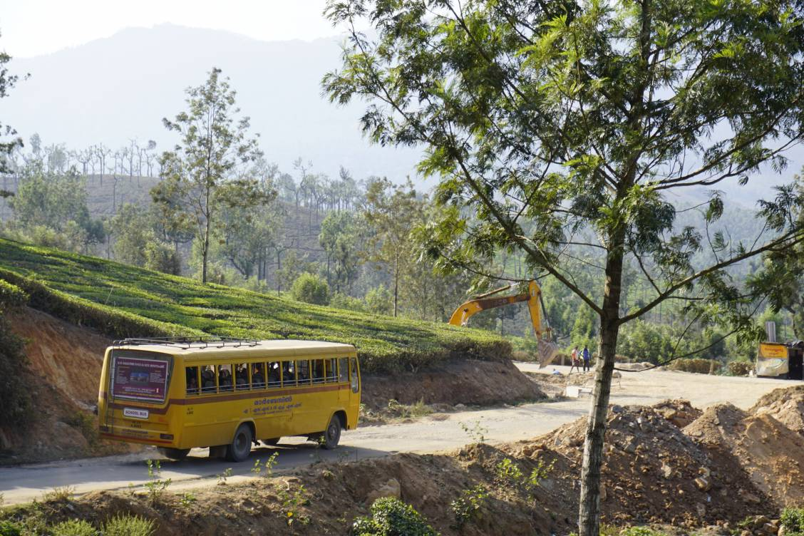 A bus in India going around a curve in a road