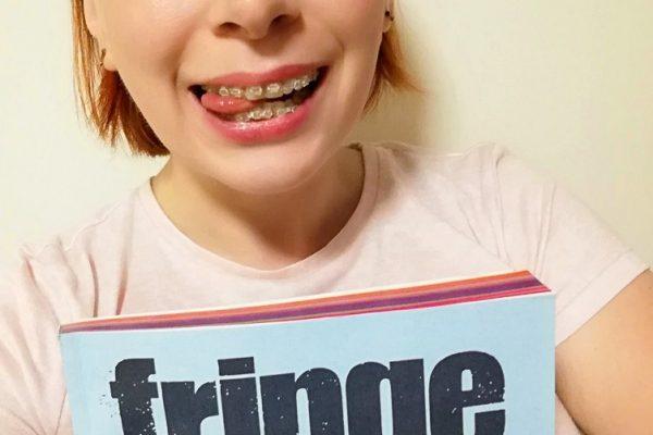 Alice Teacake holding the Fringe Festival programme guide