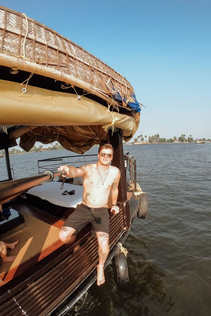 Jonny Melon takes a selfie on a houseboat in river