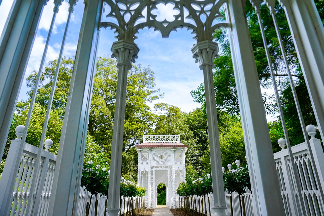A beautiful white Chinese portico within the forest of Jupiter Artland
