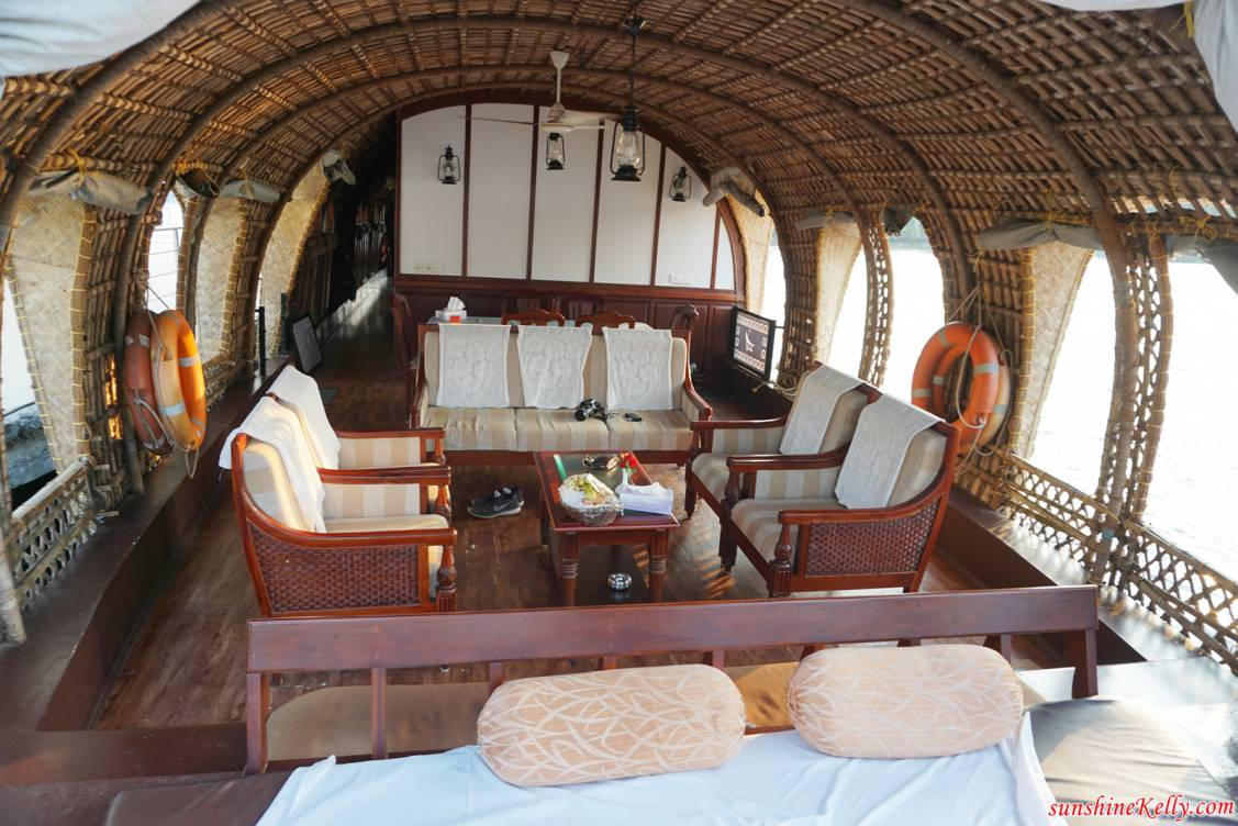 The inside of Lakes and Lagoons luxury houseboat in Kerala India