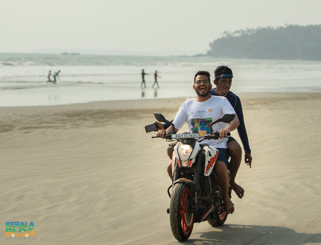 Two men on a motorbike on the beach
