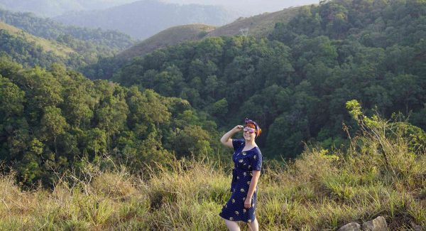Alice Teacake looking out over the lush green hills of Kerala, India