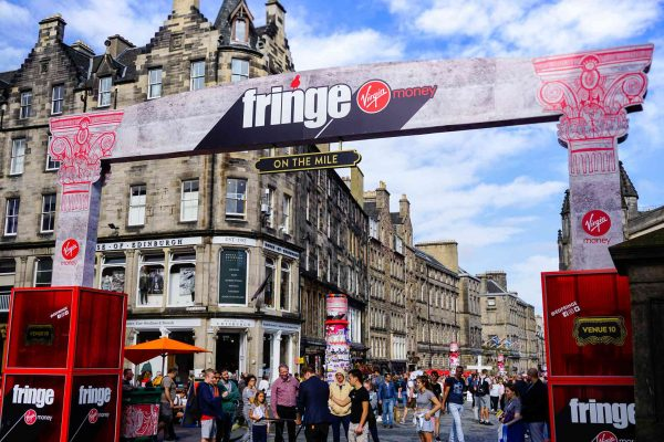 Tourists at the Virgin Money Street Event on the Royal Mile in Edinburgh Festival in Scotland