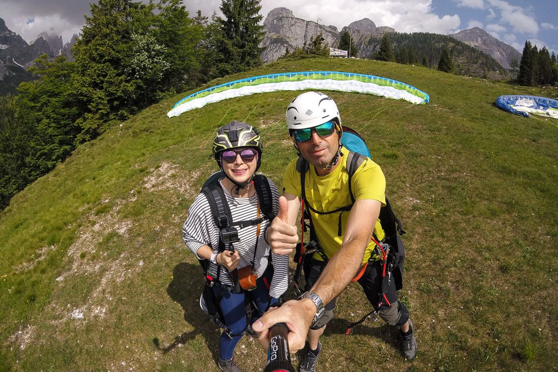 Alice Teacake and her paragliding instructor Stevano giving the thumbs up before taking off