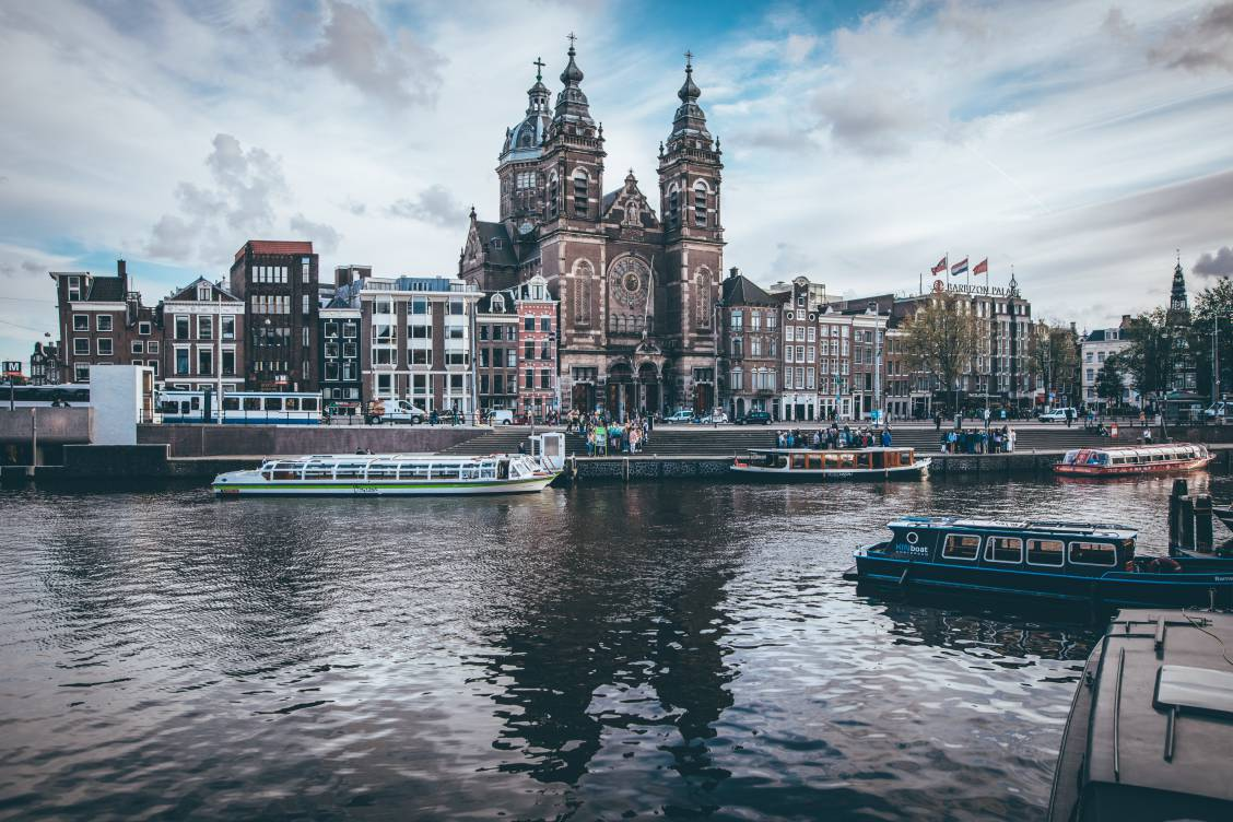 Photo of the Amsterdam Centraal Station from across the IJ