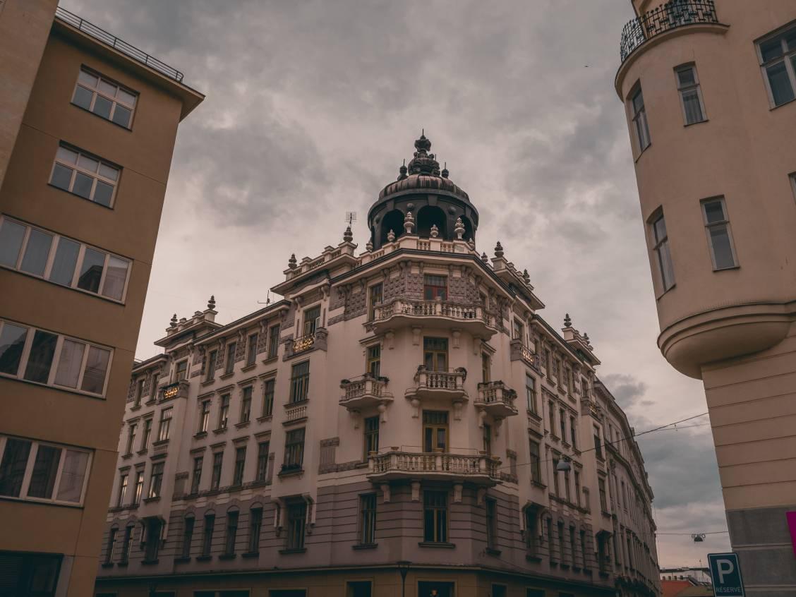 Phorto of a white domed building corner in the city of Brno, Czech Republic