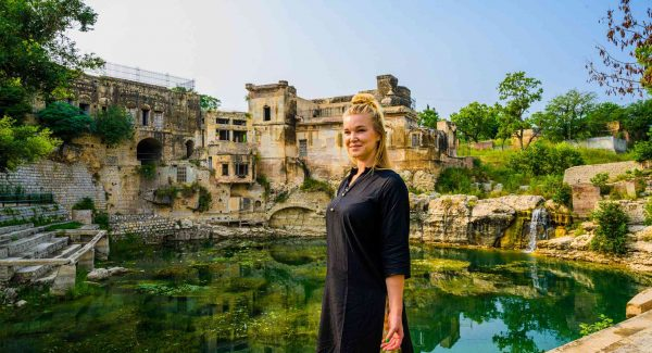 Photo of our friend in front of Katas Raj in Pakistan