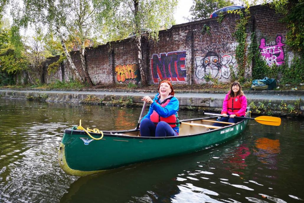 Alice Teacake and Jessica in Your Ear canoeing along Victoria Quays Sheffield on a microgap