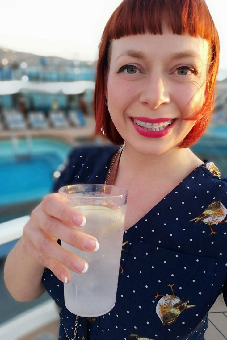 Drinking a drink on the deck of Sky Princess that I ordered with my Ocean Medallion