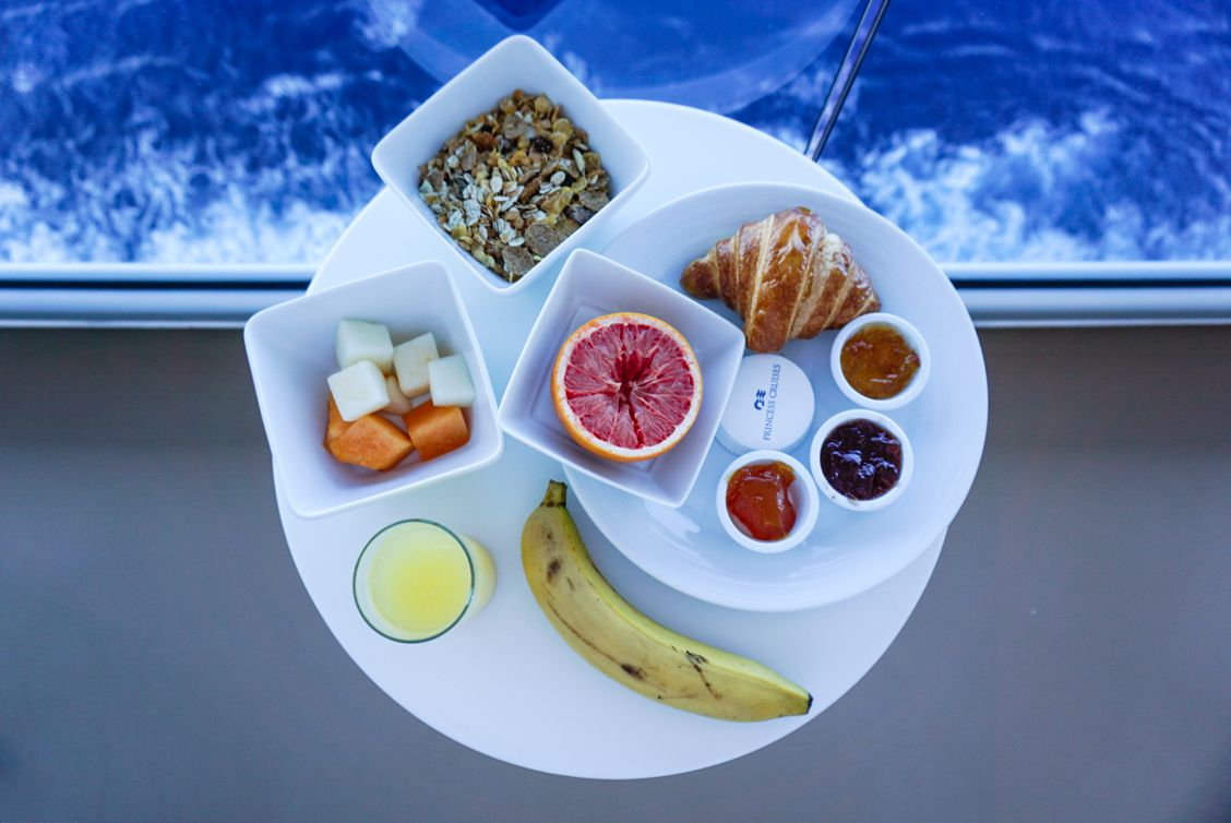 Stateroom breakfast consisting of fruit, muesli, a croissant, jams, butter, grapefruit, an orange juice and a banana - all on the Princess MedallionClass App
