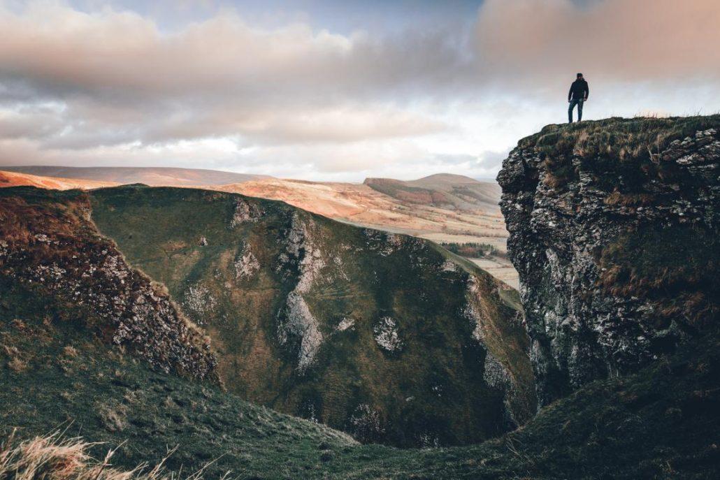 Man standing in Winnats Pass in the Peak District in Sheffield England