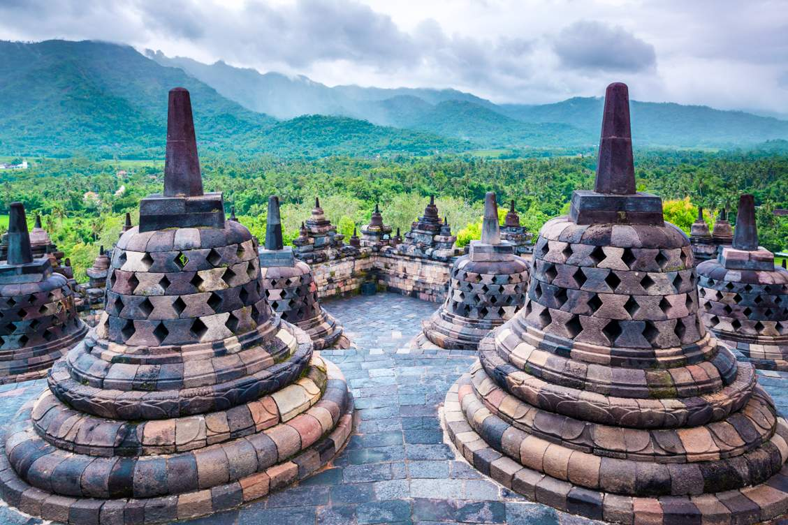 The amazing stupas in Borobudur Temple where you can see the mountains all around