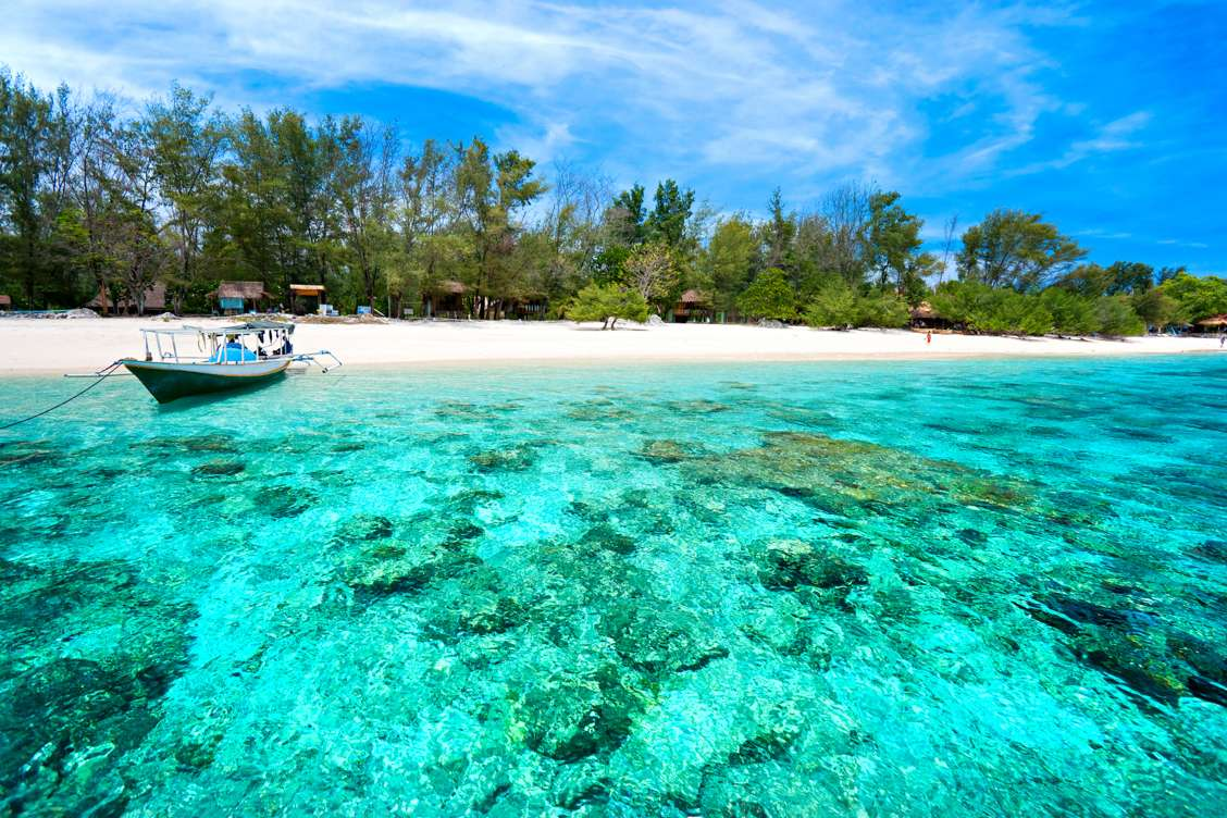 Crystal clear blue waters and golden sands on Gili Meno island in Indonesia