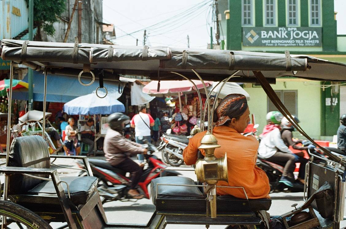 A tuk tuk driver in the busy streets of Yogyakarta Indoneis