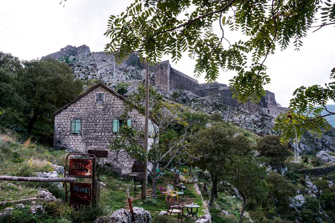 Photo of the first cafe right next to the old castle walls in the background