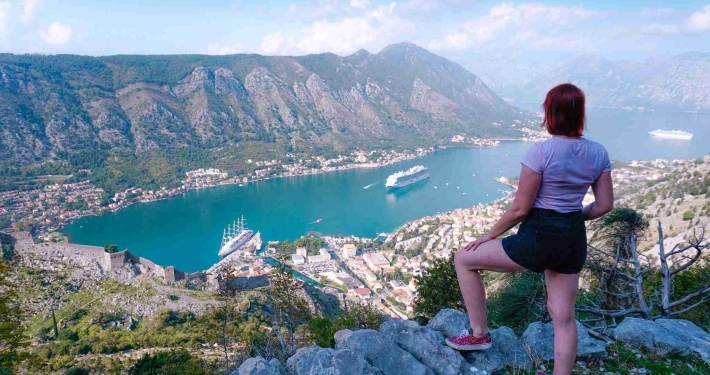 Photo of Alice looking out to the bay from the second viewpoint at the Ladder of Kotor