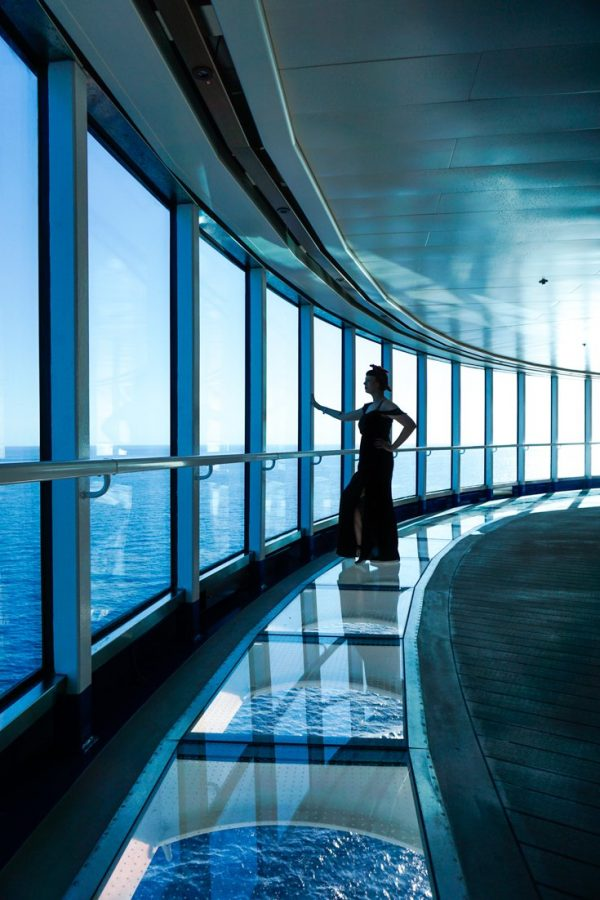 Photo of Alice standing on the glass floor in the Sea Walk looking out at the ocean