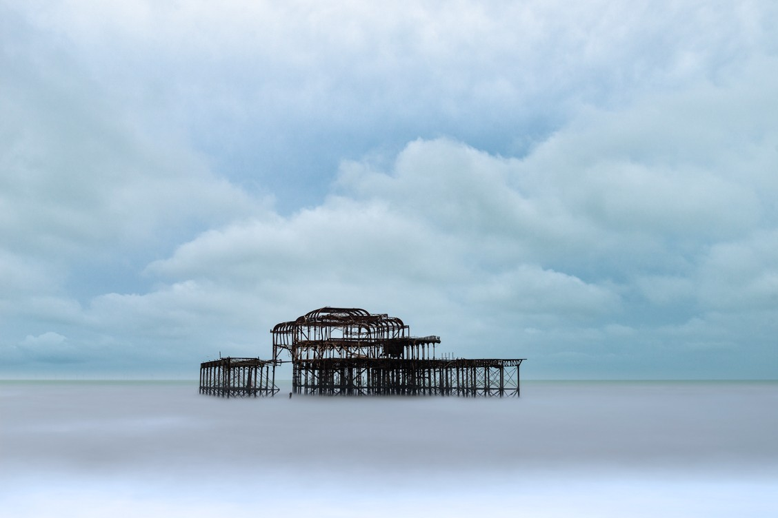 The remaining shell of Brighton West Pier standing in the sea