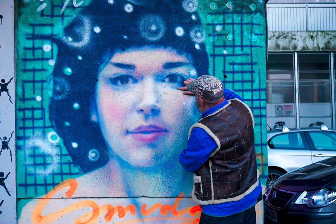 REQ, a Brighton street artist showing us one of his street art pieces of a beautiful lady called Smudge