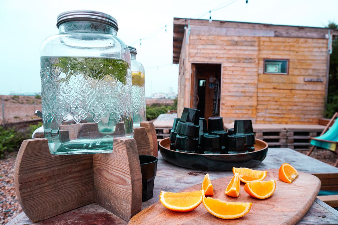 Cool mint water and oranges outside Beach Box Spa horseboxes on the beach