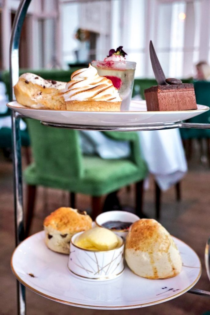 Two plates of delicious cakes and scones at The Grand Hotel in Brighton