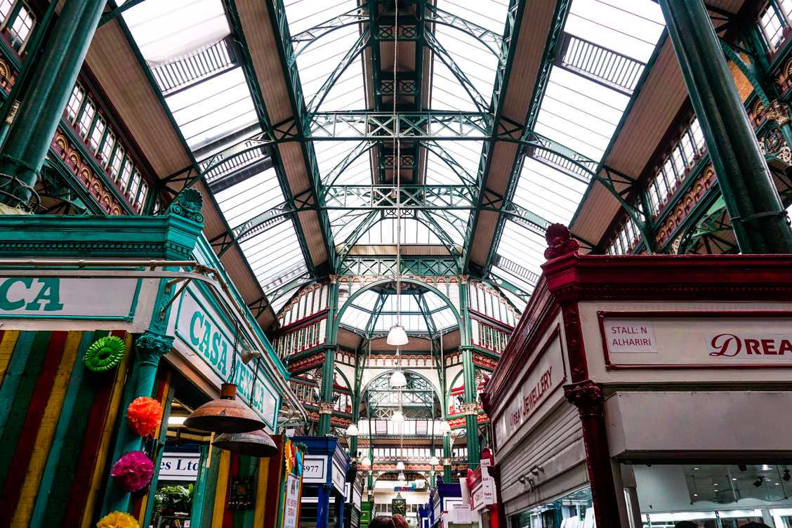Looking up inside Leeds Kirkgate Market at the stunning architecture