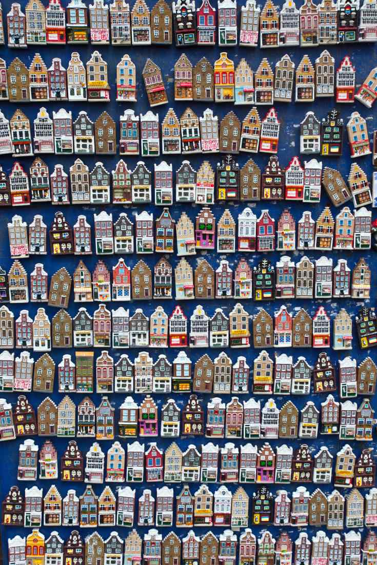 Collect travel memories through fridge magnets - here's a whole array of cute Amsterdam houses to choose from