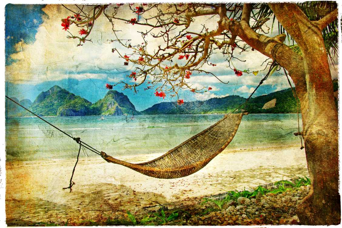 Travel postcard depicting a hammock attached to a blossoming tree along the beach with mountains in the background
