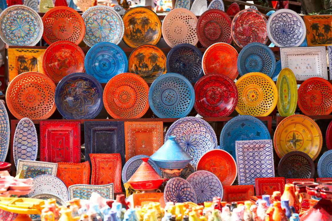 Colourful earthenware along the side of a street