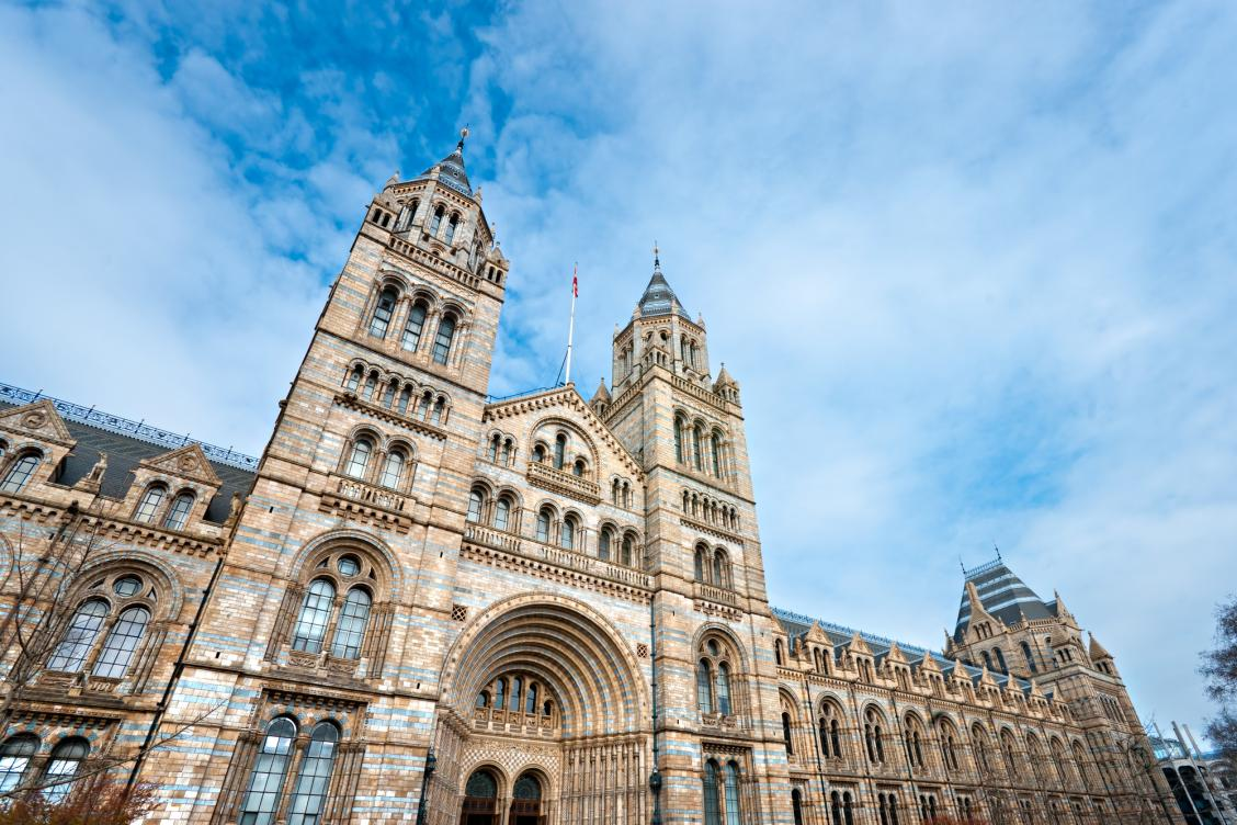 Facade of Natural History Museum with clear blue skies