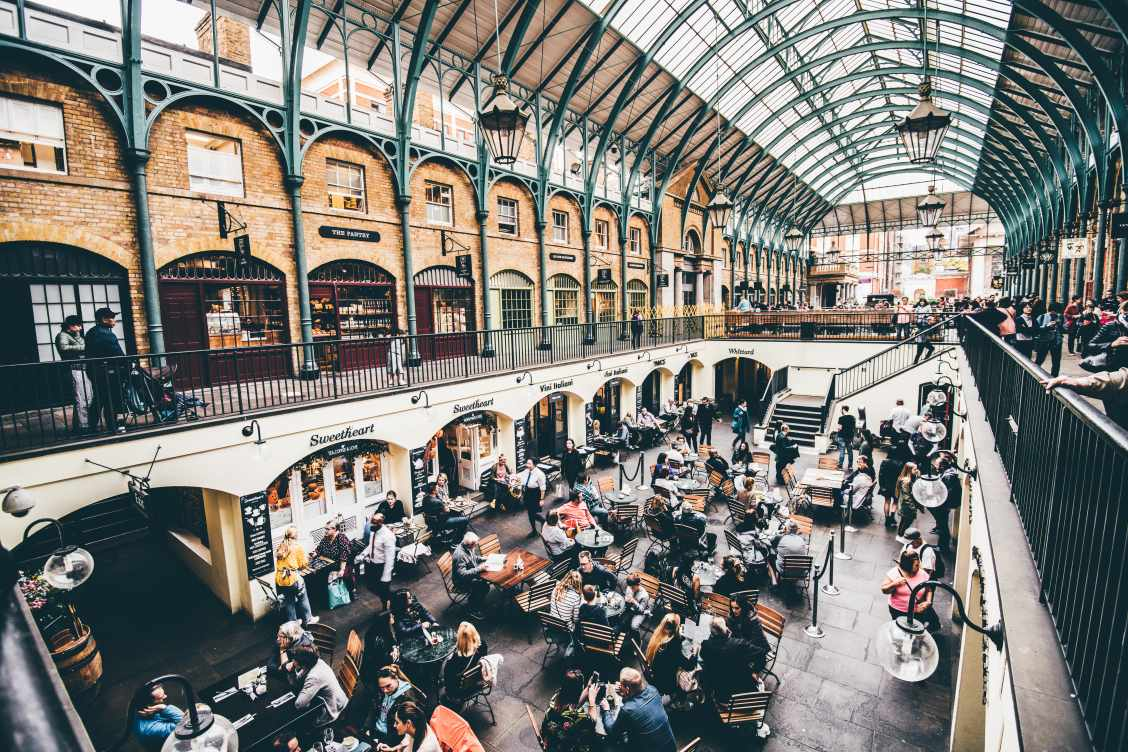 Covent Garden in London with lots of people enjoying the food and shopping on offer during their day out with kids